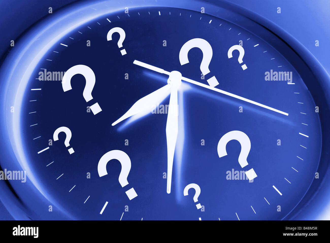 Wall Clock with Question Marks - Stock Image