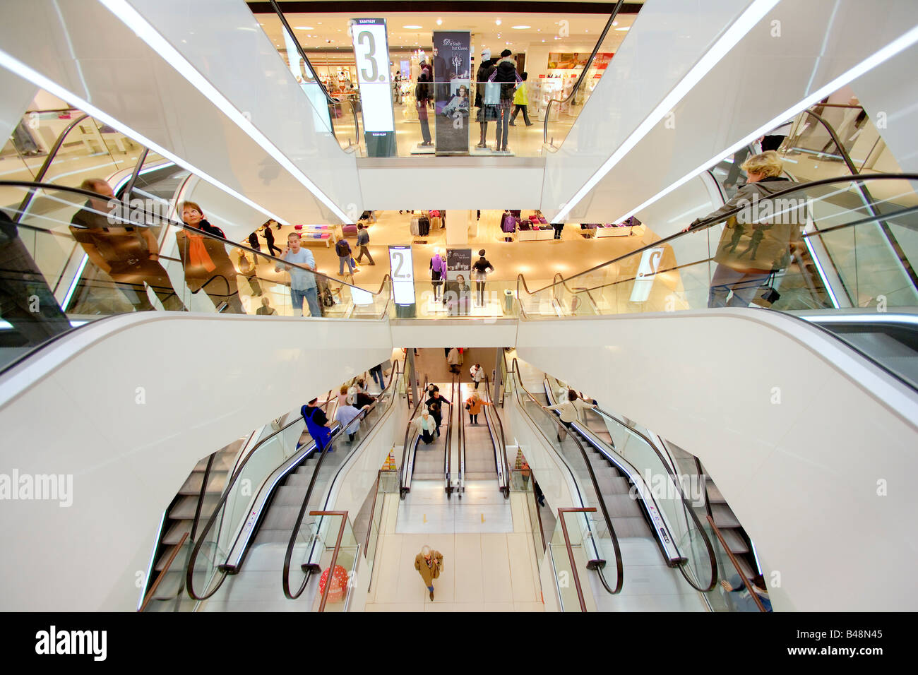Escalators in a newly renovated department store of the Karstadt Warenhaus GmbH in Hamburg, Germany - Stock Image