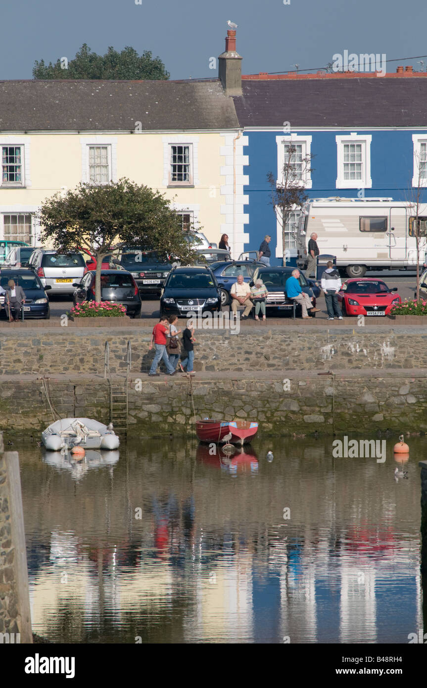 People walking along the quayside at Aberaeron Ceredigion Wales UK - Stock Image