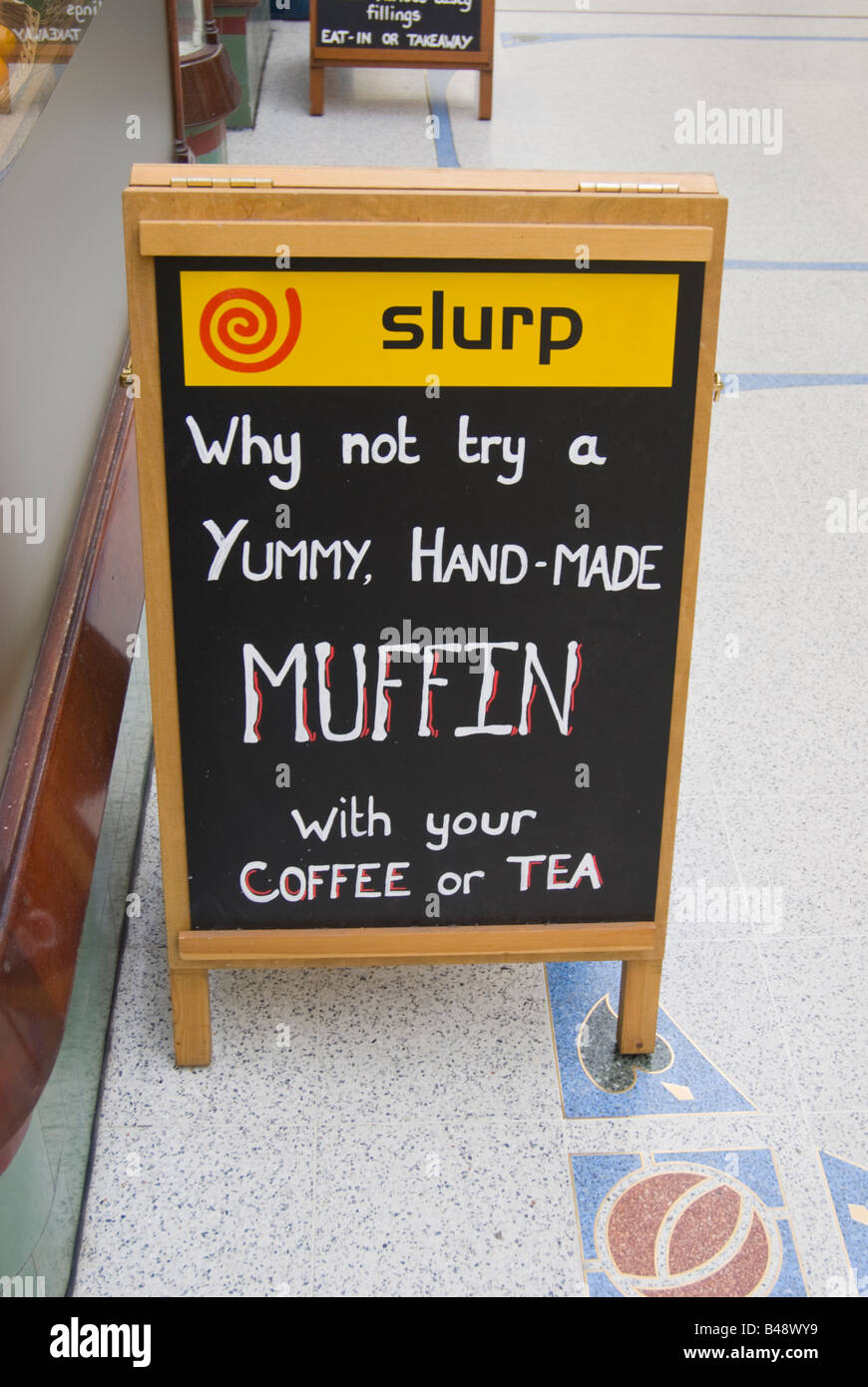 Sign advertising home made muffins outside Slurp shop in Norwich,Norfolk,Uk - Stock Image