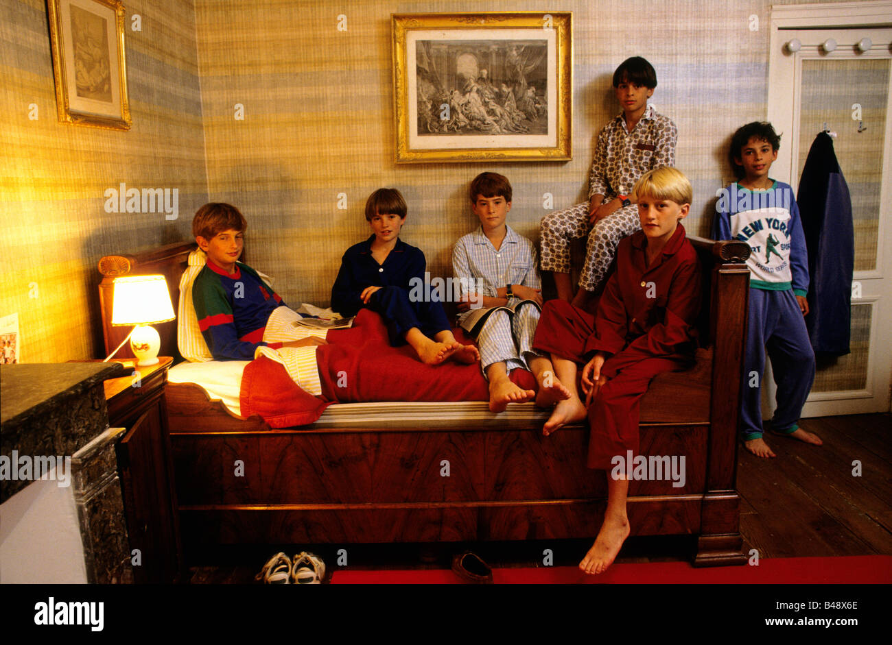 Boys wearing pyjamas in their dorm as they get ready for bed at the end of the day - Stock Image