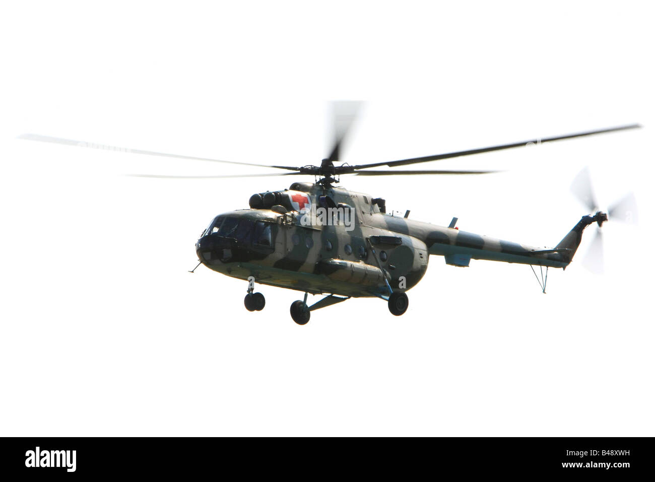 Flying military helicopter isolated on white - Stock Image