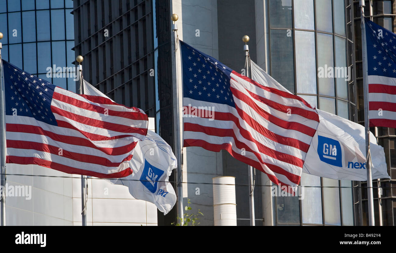 Detroit Michigan Flags of the United States and General Motors flying together outside the GM headquarters - Stock Image