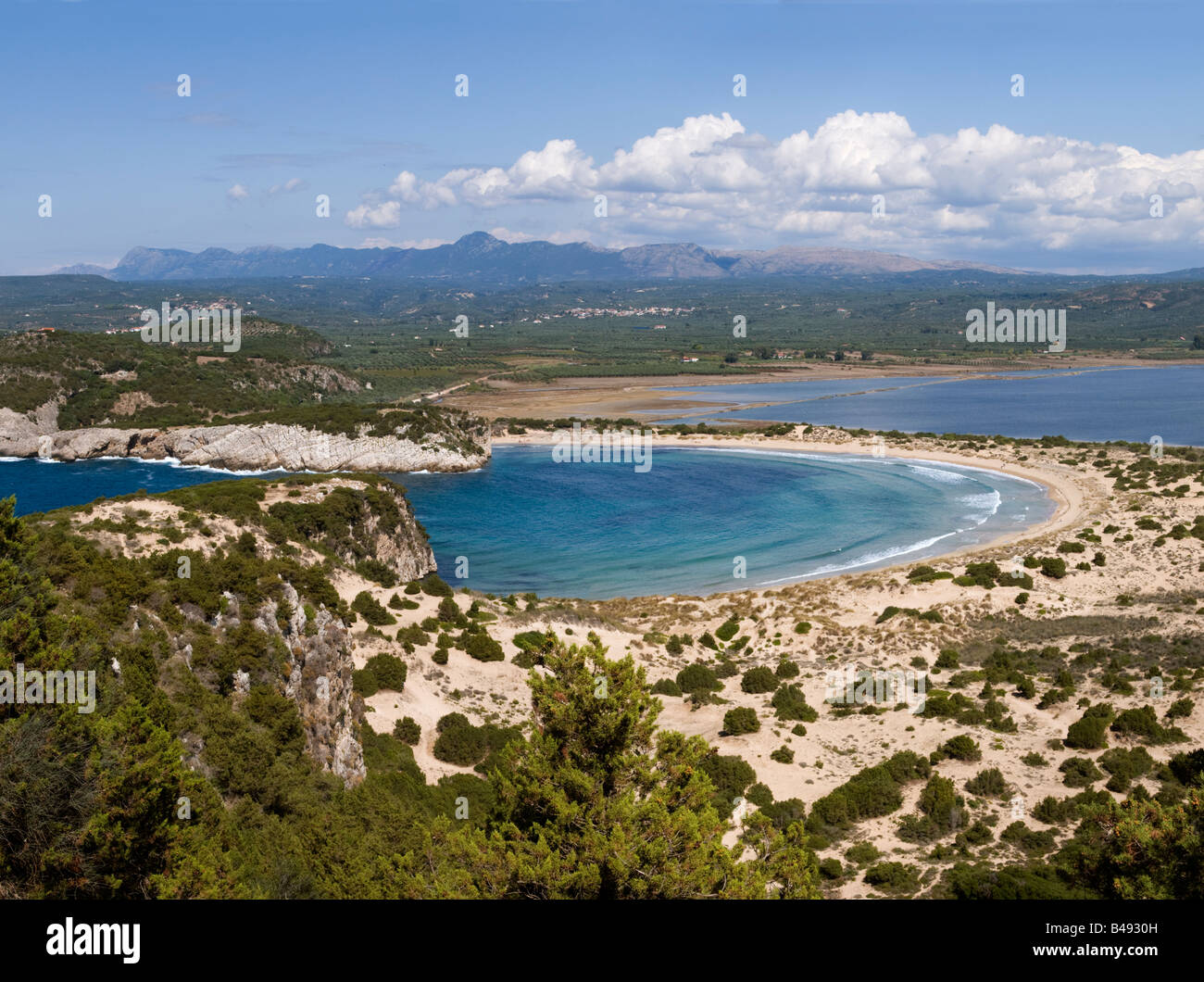 Voidokilia bay with the lagoon and bird conservation area in the background just north of Yialova and Pylos, Peloponnese - Stock Image