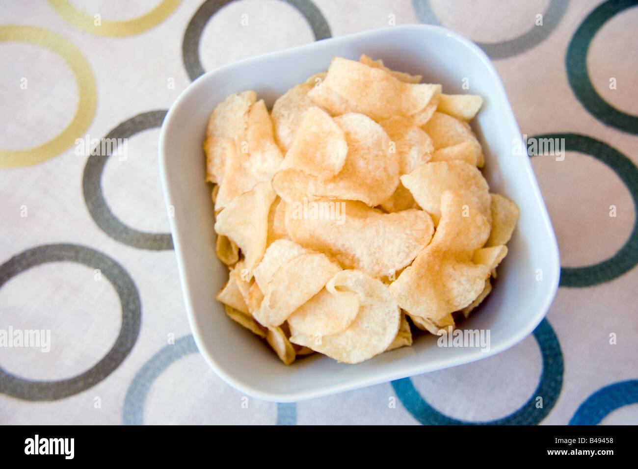 A bowl of potato chips - Stock Image