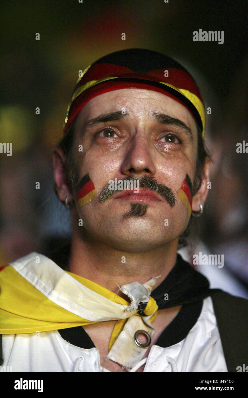 German football fan crying after the German defeat against Italy at the FIFA World Cup 2006, Berlin, Germany - Stock Image