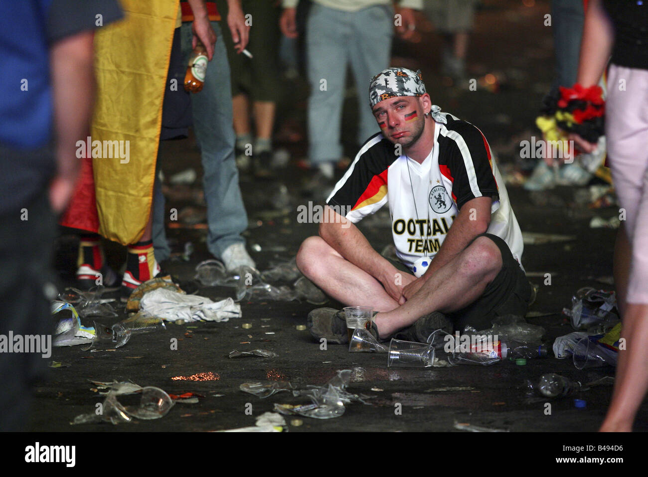 A disappointed German football fan after the German defeat against Italy at the FIFA World Cup 2006, Berlin, Germany - Stock Image