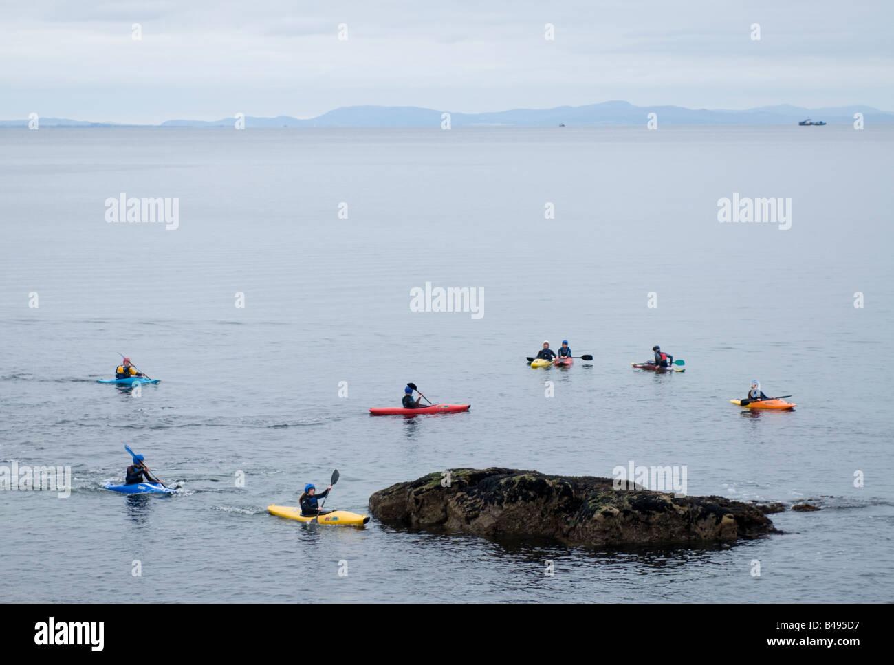 Sea Kayaking at Hopeman in the Moray Firth North East Scotland UK - Stock Image