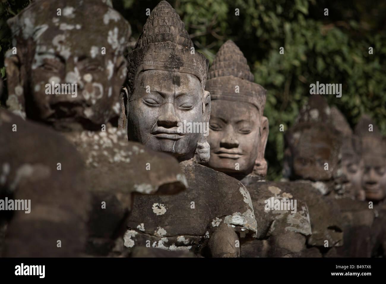Statues lining main gates of ancient city, Angkor Wat, Cambodia - Stock Image