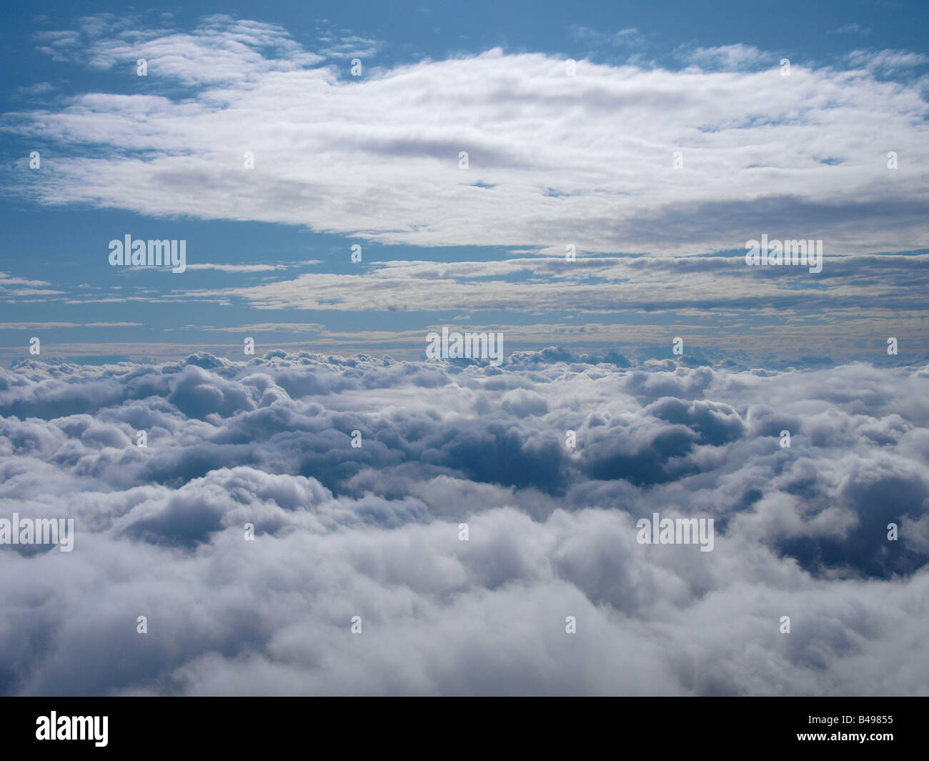 Flying above the clouds Picture taken at 19000 feet above the English Channel - Stock Image