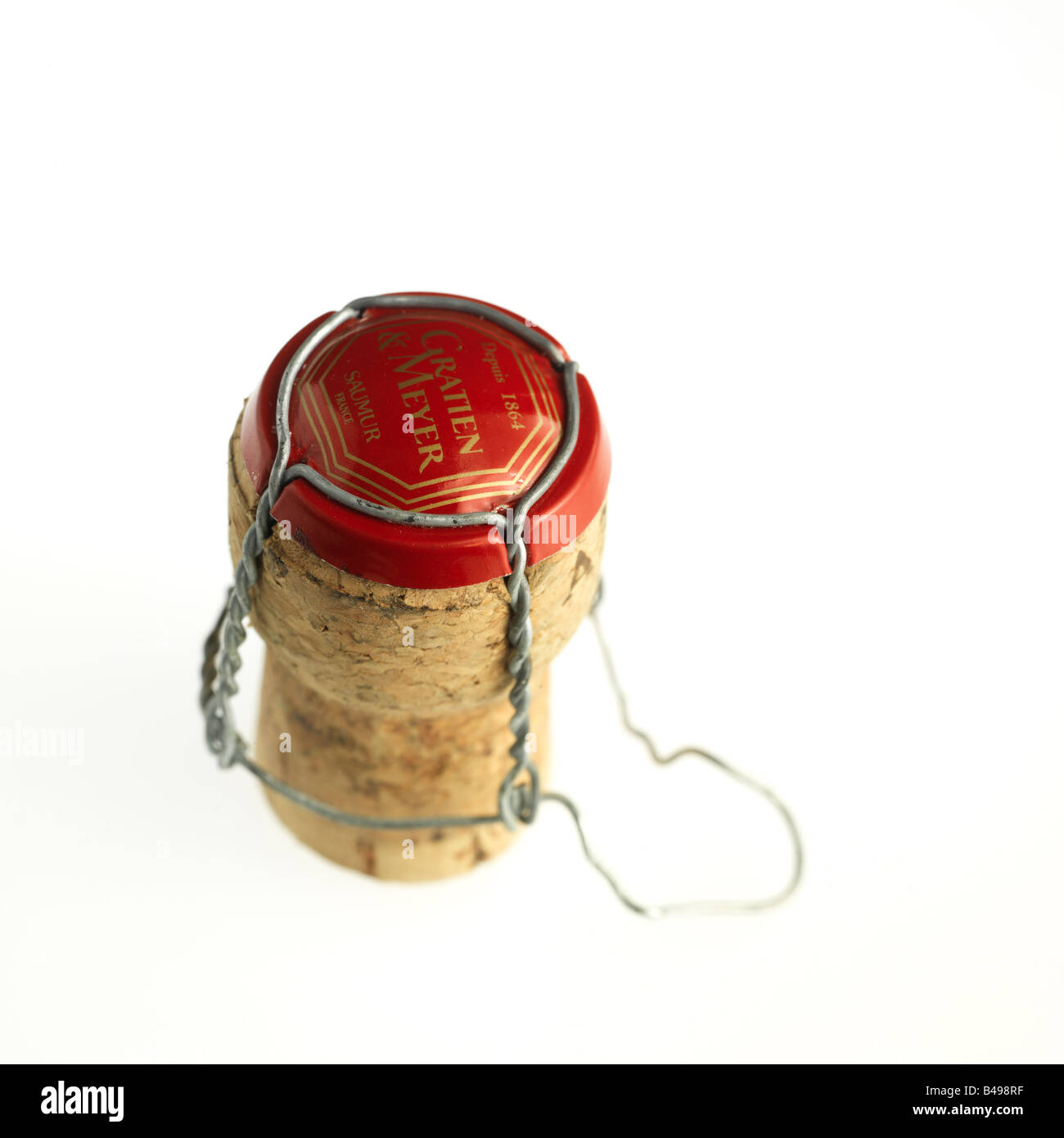 Champagne cork with metal crown wire cage. - Stock Image