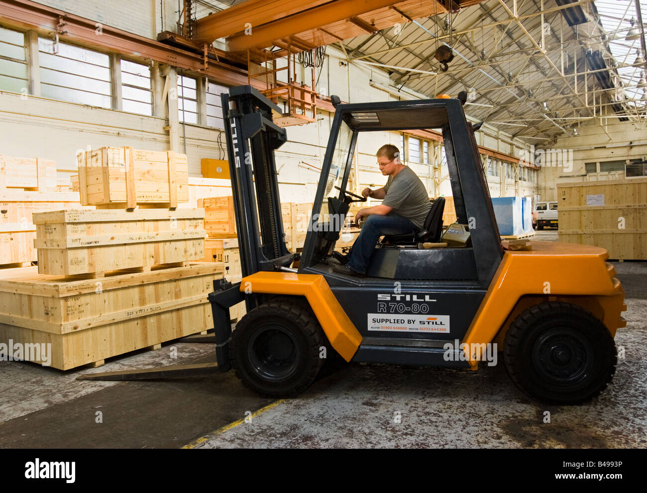 Forklift truck driver, warehouse, UK - Stock Image