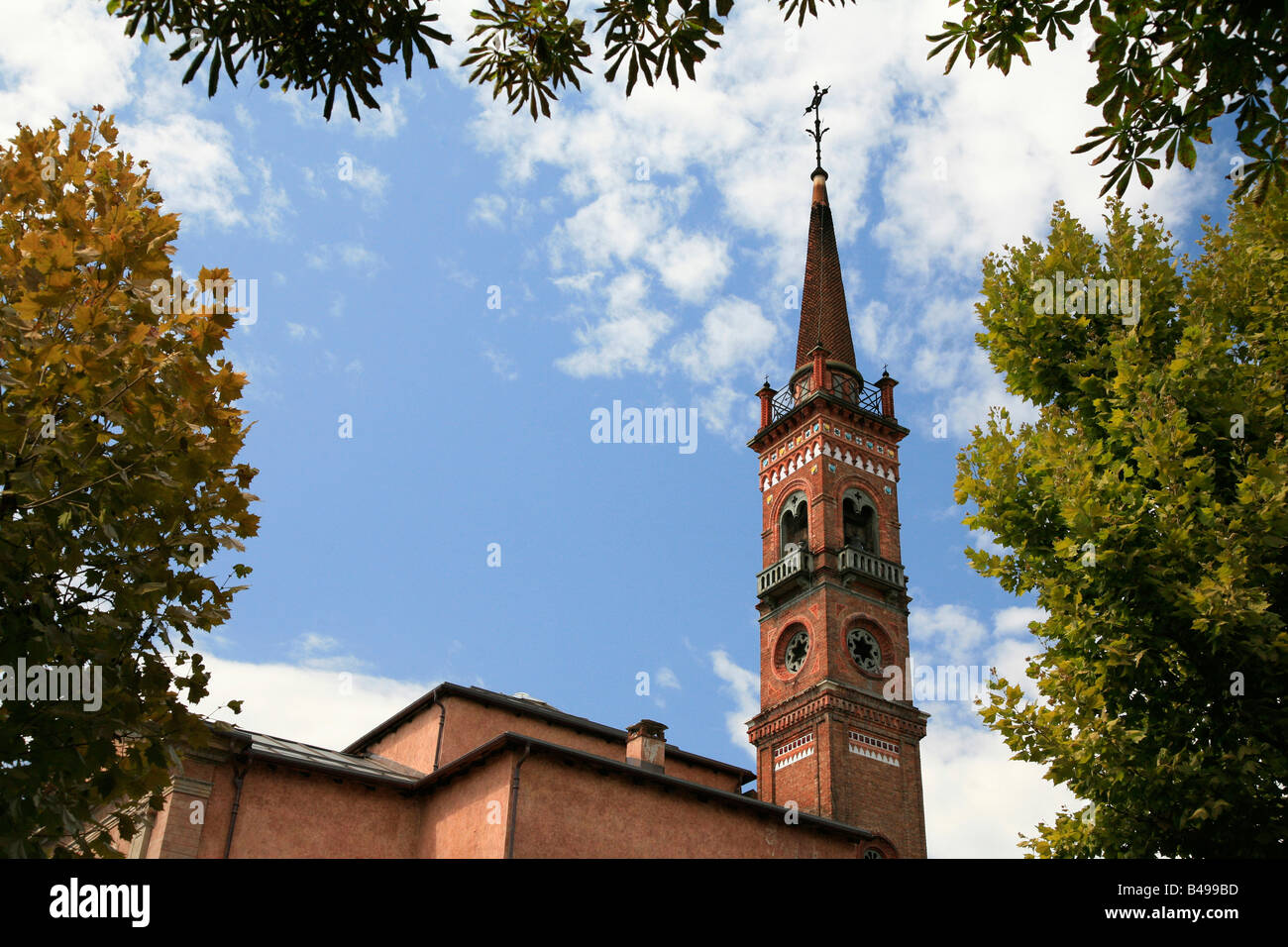 Tall church spire in medieval part of town in Cuneo Piemonte Italy - Stock Image