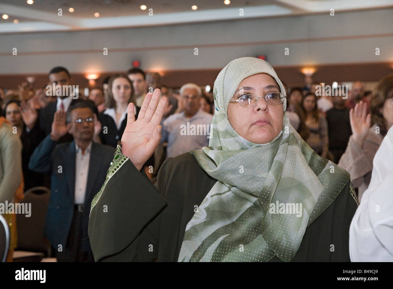 Detroit Michigan A woman from Iraq is among a group of immigrants sworn in as new U S citizens - Stock Image
