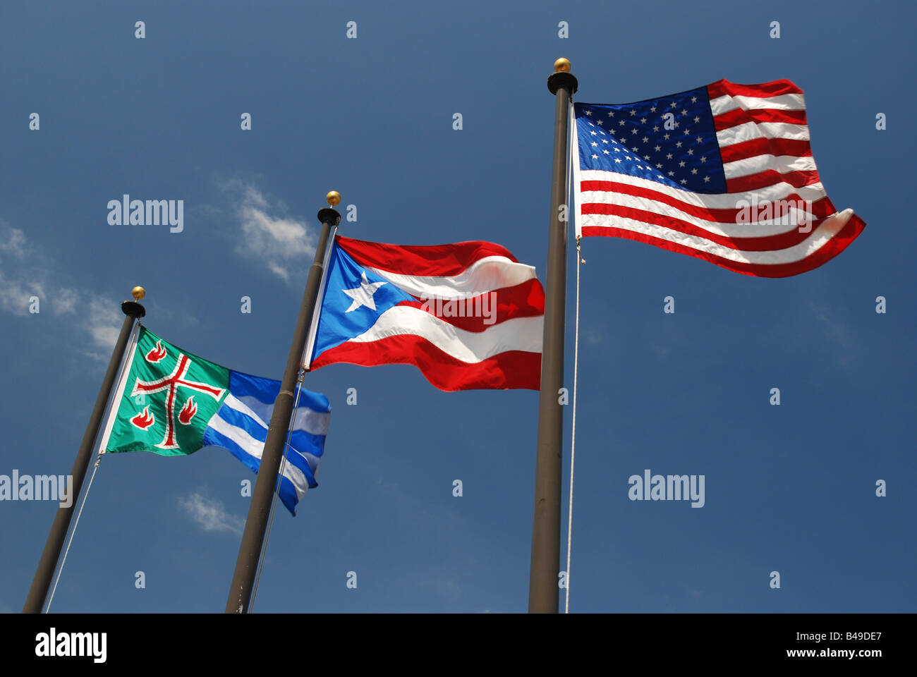 The flags of Mayagüez, Puerto Rico and the United States of America. - Stock Image