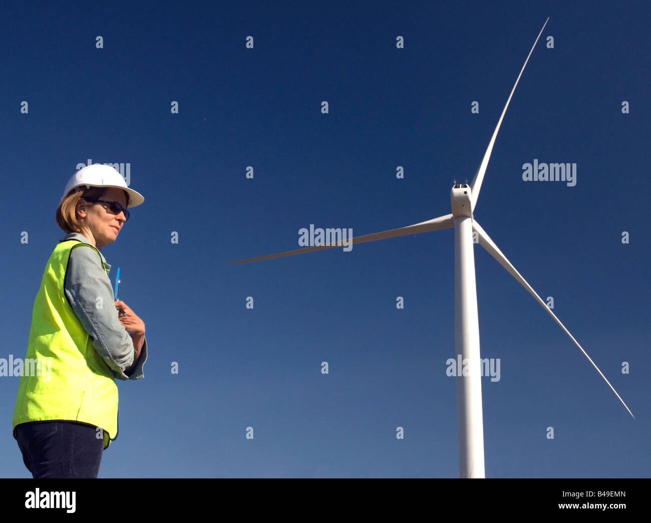 Female engineer at wind turbine wind farm - Stock Image