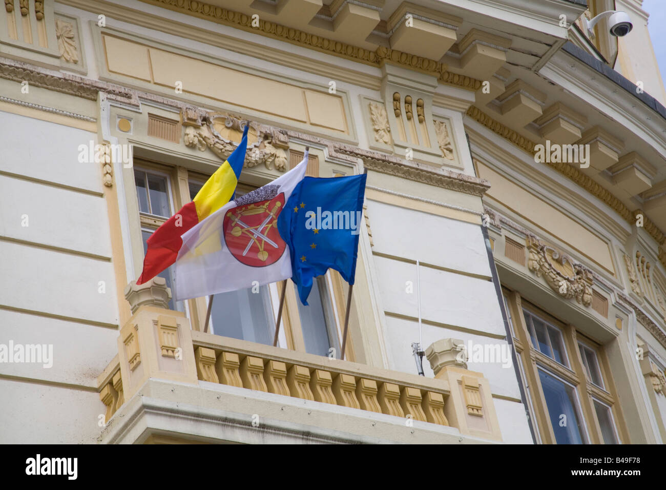 Sibiu Transylvania Romania Europe September Romanian city and European Union flags flying from a balcony of the - Stock Image