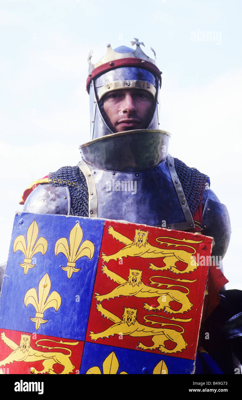 Medieval Knight King Prince historical re-enactor Royal Arms crown armour re-enactment coat of arms heraldry lions - Stock Image