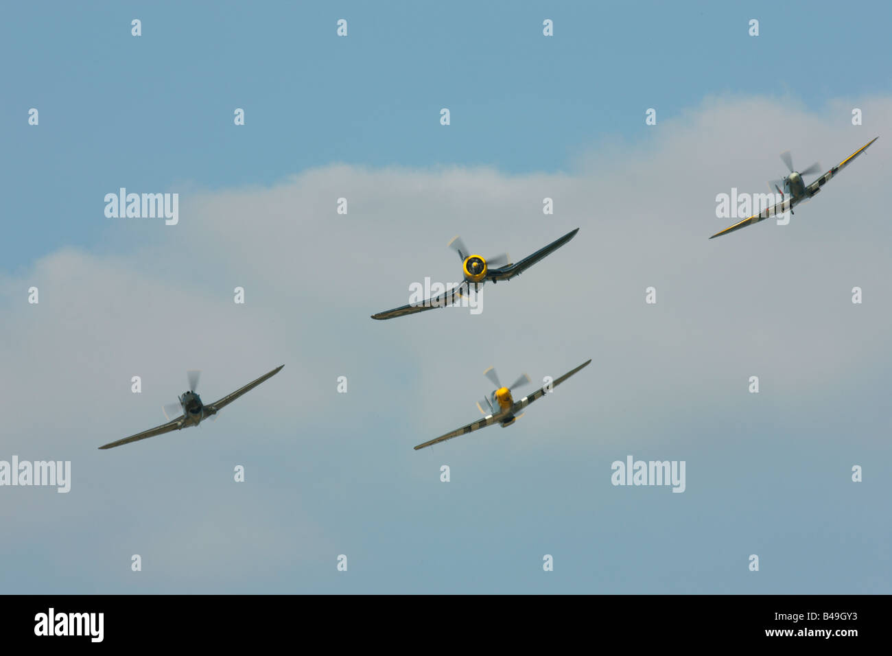 Spitfire,Corsair, Warhawk, Mustang in formation - Stock Image