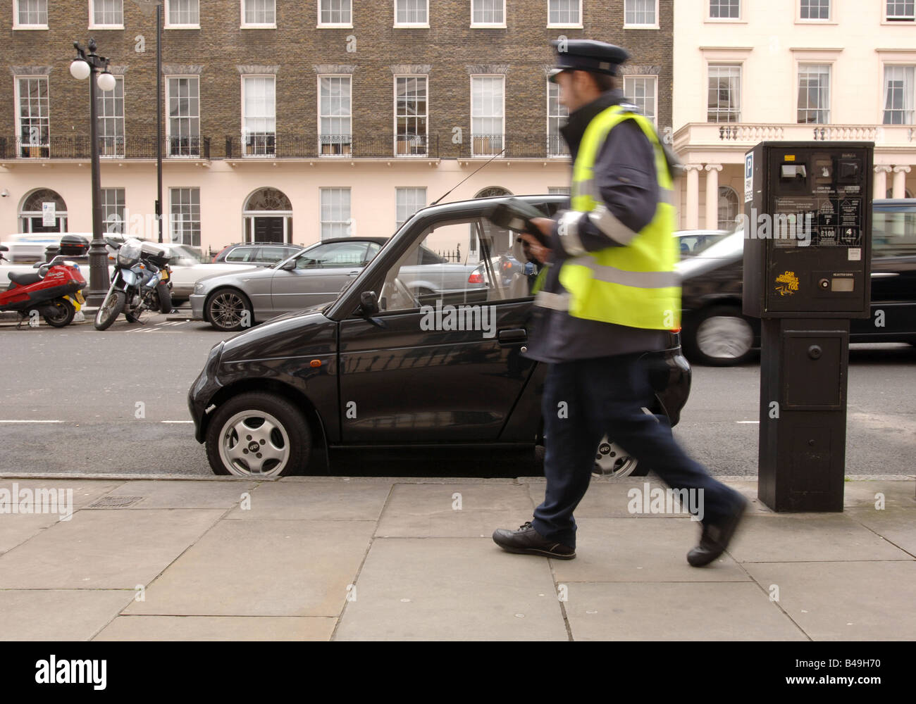 G-Wiz electric car parked for free in London, ignored by a traffic warden despite having no parking ticket - Stock Image