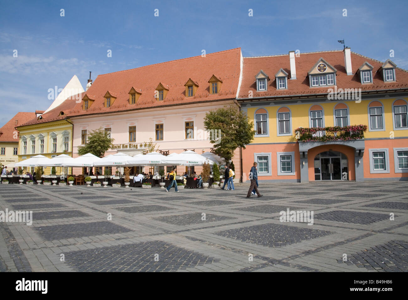 Sibiu Hermannstadt Transylvania Romania Europe September People sitting at tables in front of hotel in traffic free Stock Photo