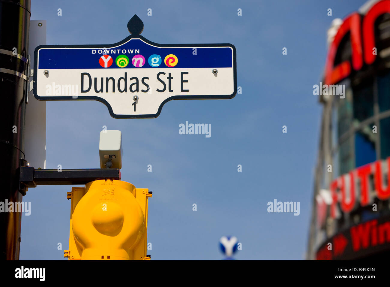 Street sign on the corner of Yonge and Dundas Streets (Yonge Dundas Square) in downtown Toronto, Ontario, Canada. - Stock Image
