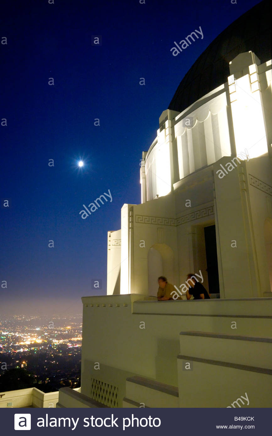 Two Male Tourists Enjoying Scenic City View from the Griffith Observatory Rooftop Los Angeles California - Stock Image