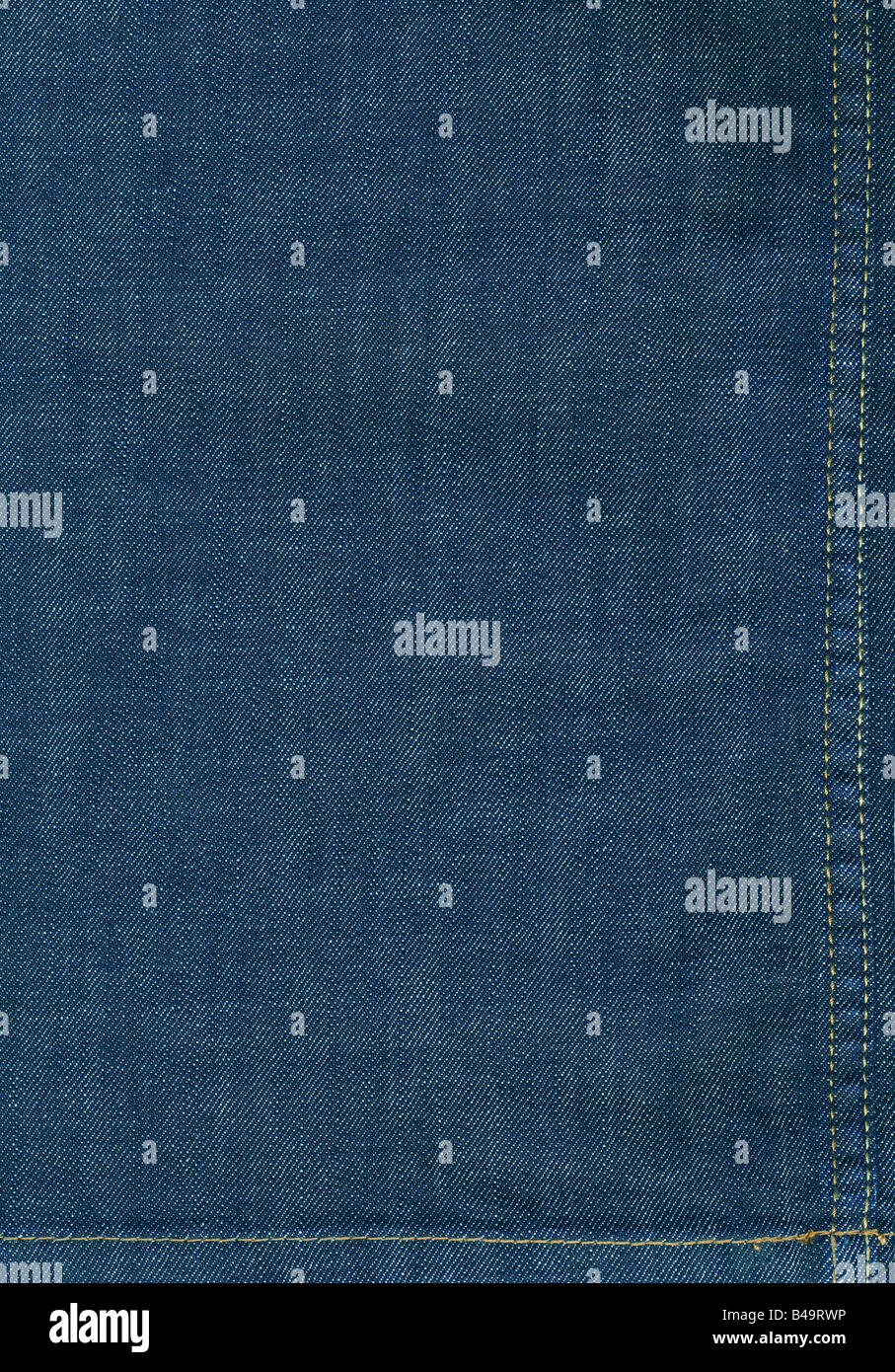 Flat background image of dark blue denim fabric with seams large XXL high resolution image - Stock Image