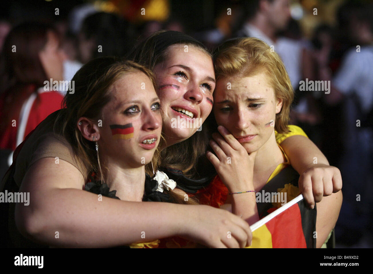German football fans crying after the German defeat against Italy at the FIFA World Cup 2006, Berlin, Germany - Stock Image