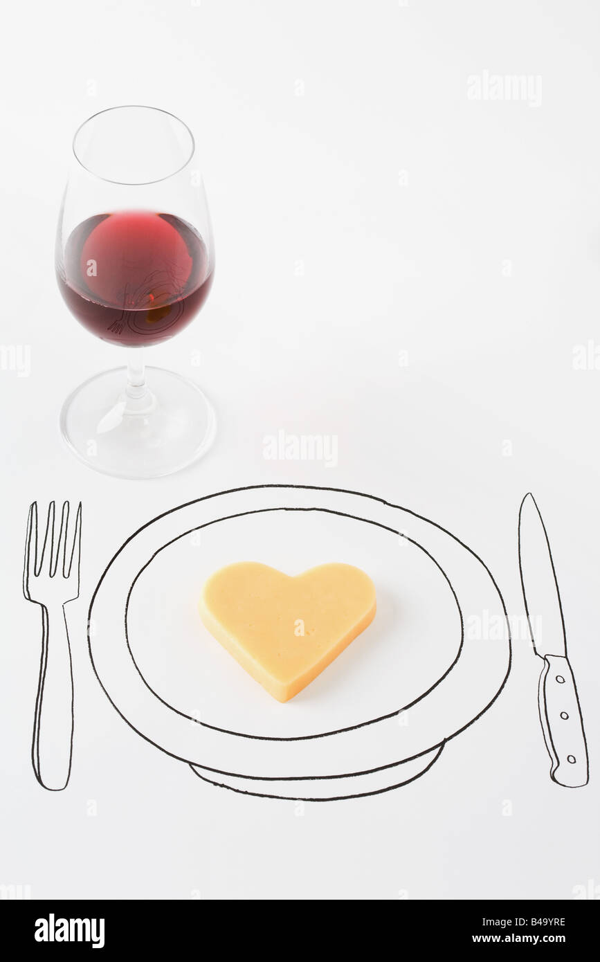 Heart-shaped cheese on drawing of plate, glass of red wine nearby - Stock Image