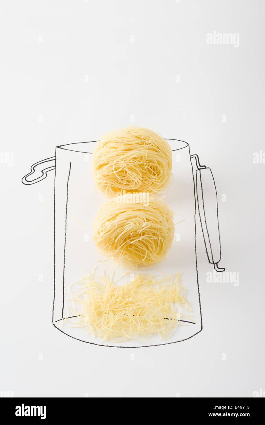 Noodles in canister, broken pieces at the bottom - Stock Image