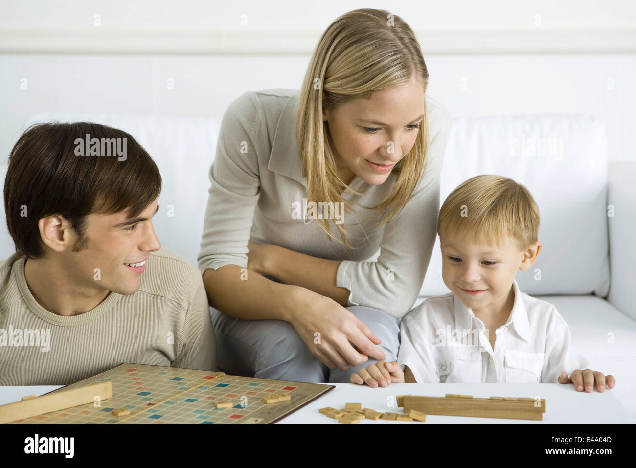 Family playing board game together Stock Photo