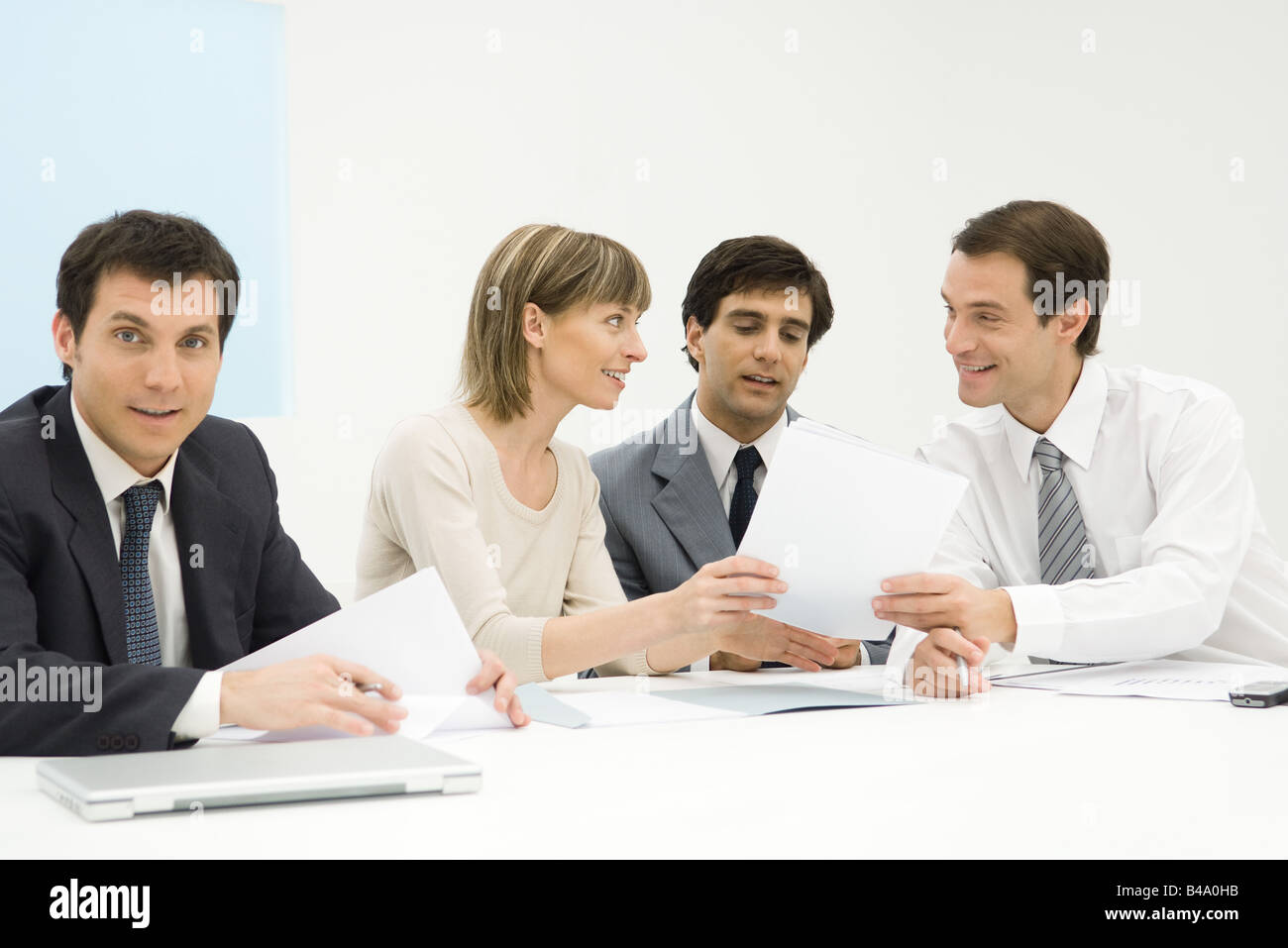 Business people in meeting, discussing document - Stock Image