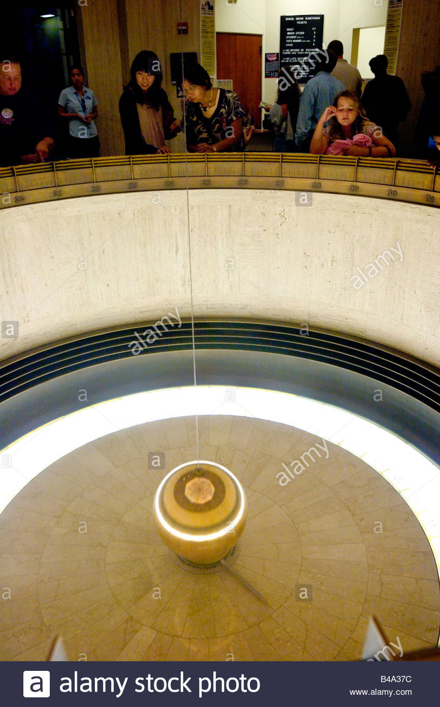 Foucault Pendulum in the W M Keck Foundation Central Rotunda Griffith Observatory Los Angeles California - Stock Image
