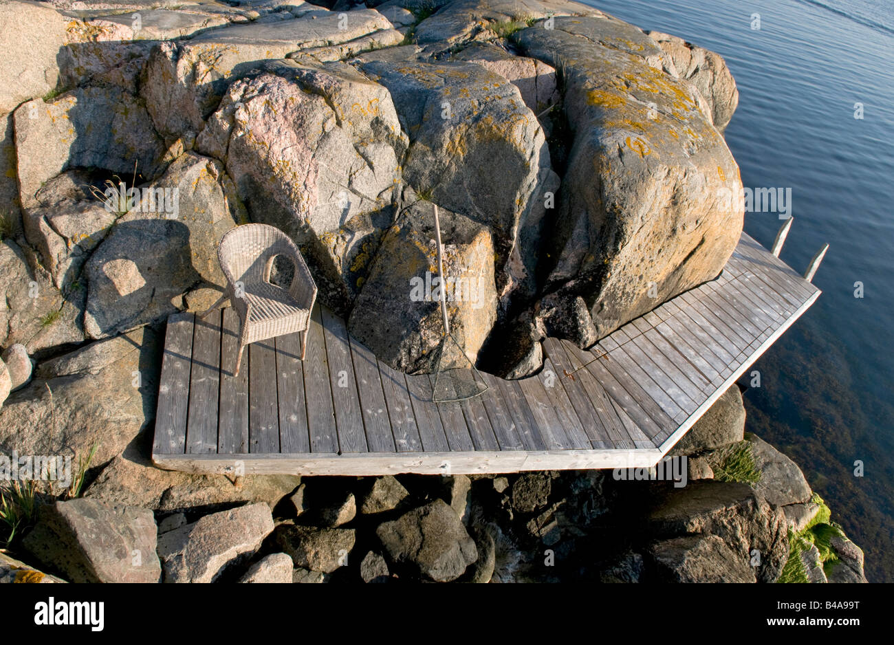 Jetty among rocks in the Stockholm archipelago - Stock Image