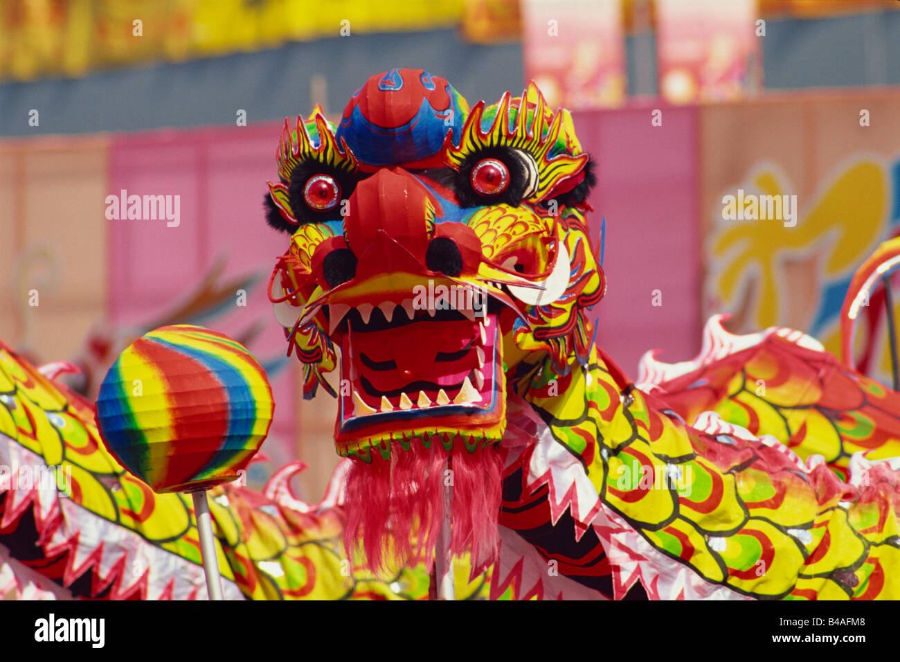 China, Hong Kong, Traditional Chinese Dragon Dancing - Stock Image