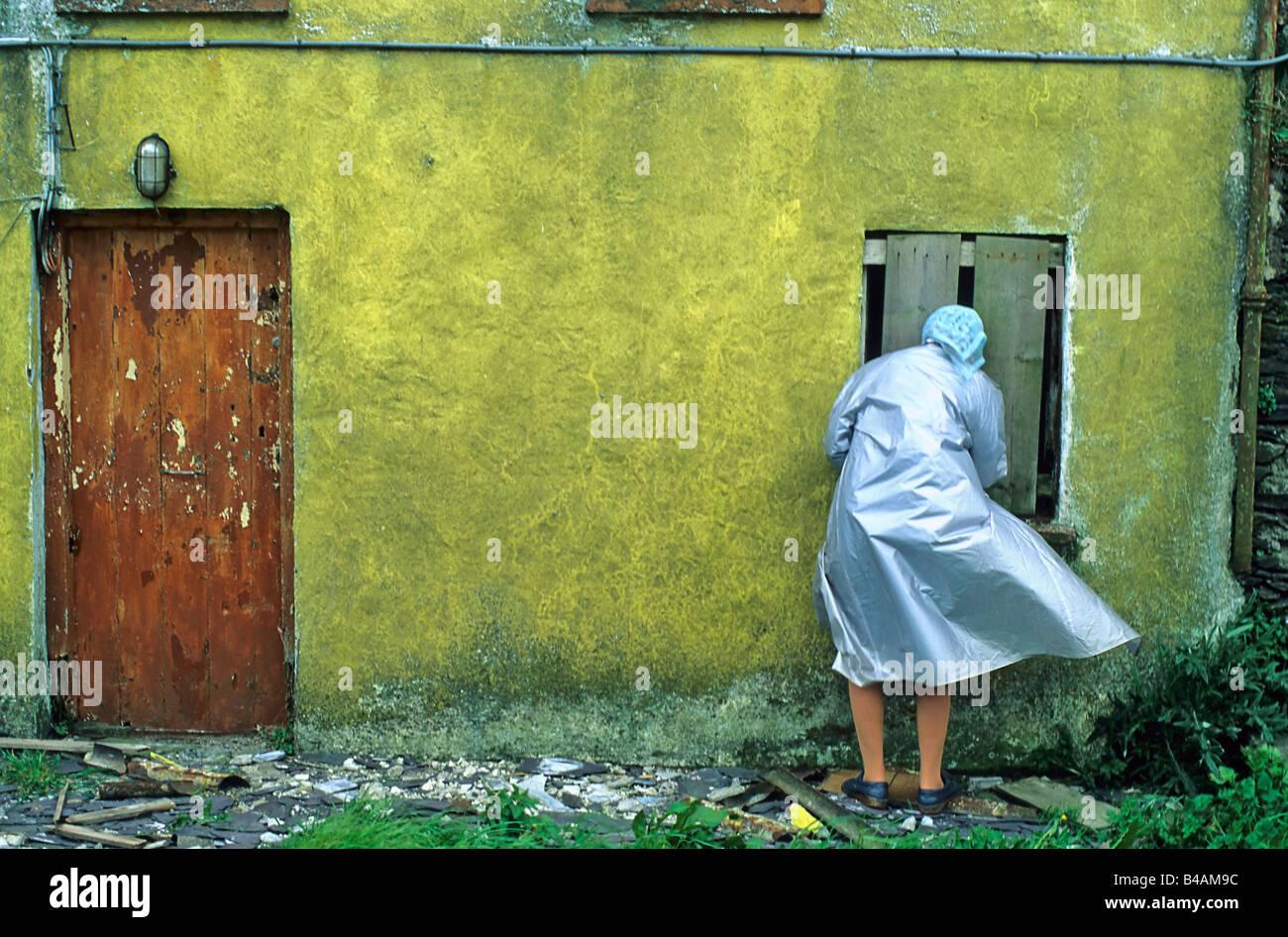 countrywoman at the frontdoor ireland - Stock Image