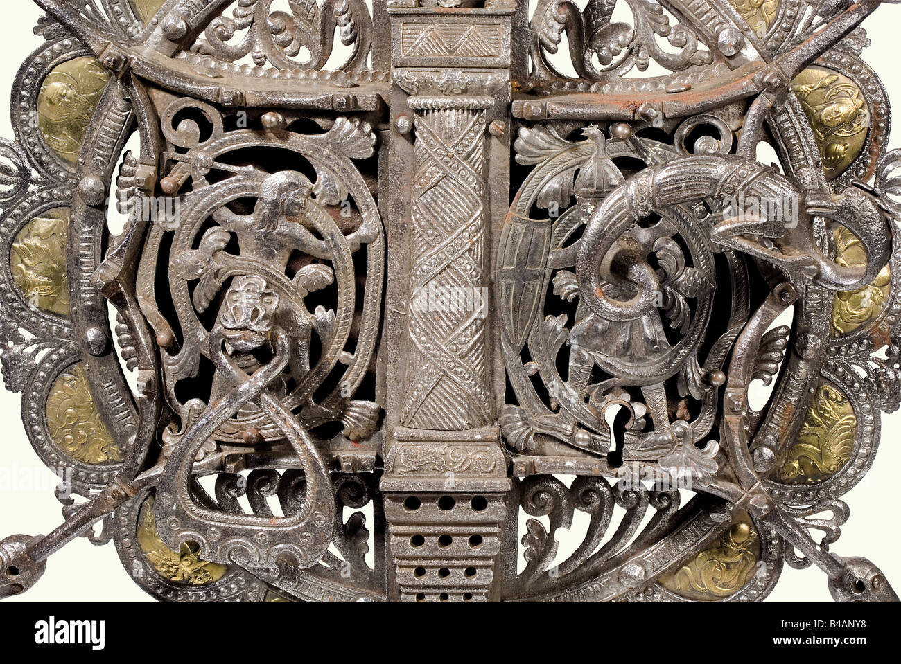 A large Viennese(?) gate lock, in the Roman style, circa 1900. Forged iron. Round, two-piece lock screen set with - Stock Image