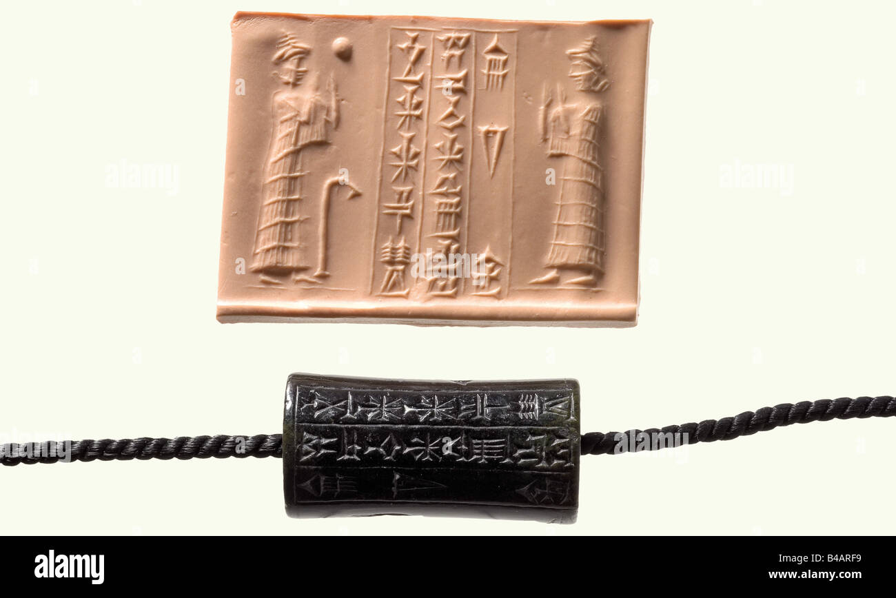 A Babylonian roller seal, 1844 - 1750 B.C. Black, light green stone, convex in the middle. Cut (intaglio) owner's - Stock Image