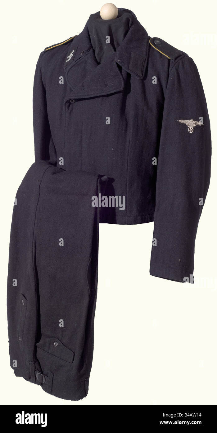 A black Panzer uniform for an enlisted man, of a reconnaissance unit. Field jacket of black wool, grey wool lining - Stock Image