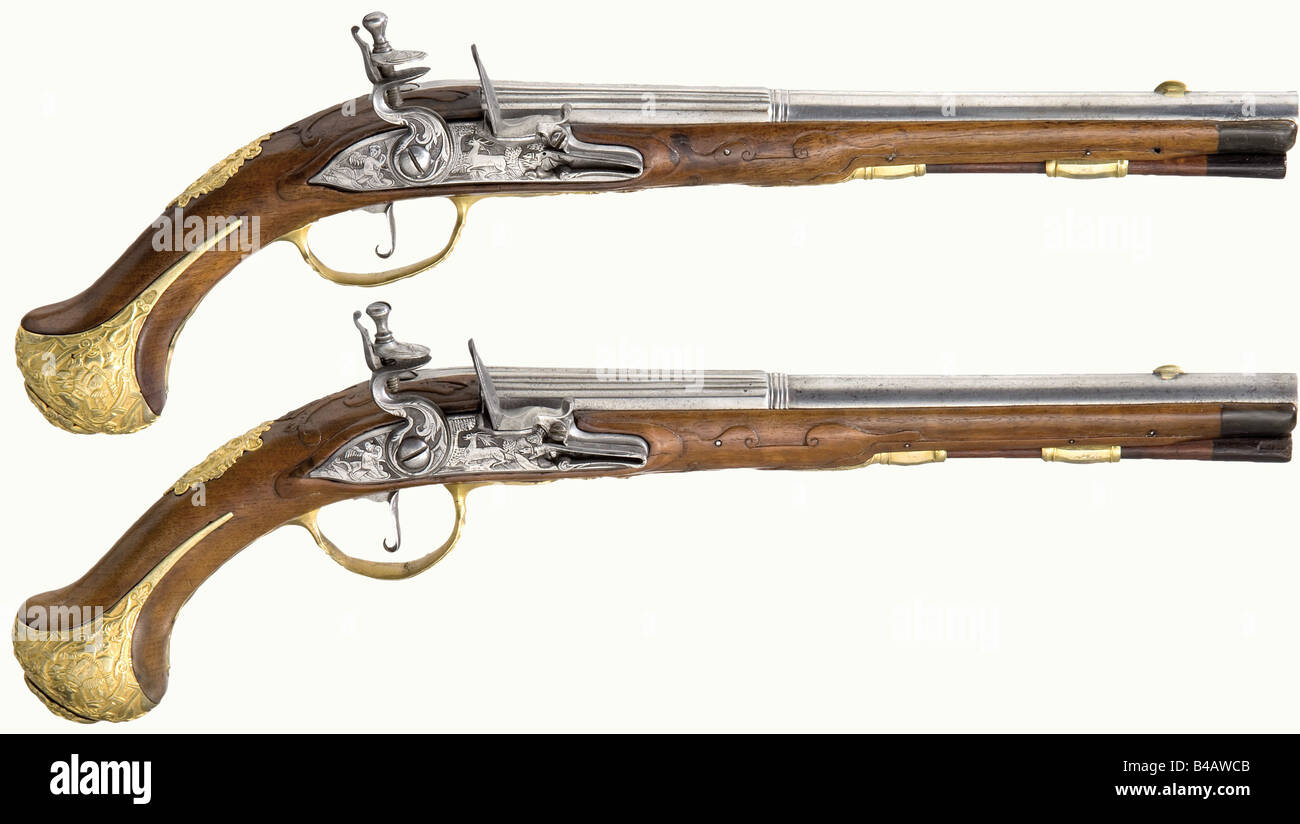 A pair of flintlock pistols, Karlsbad, circa 1720. Barrels fluted in the Italian style over the breeches, smooth - Stock Image