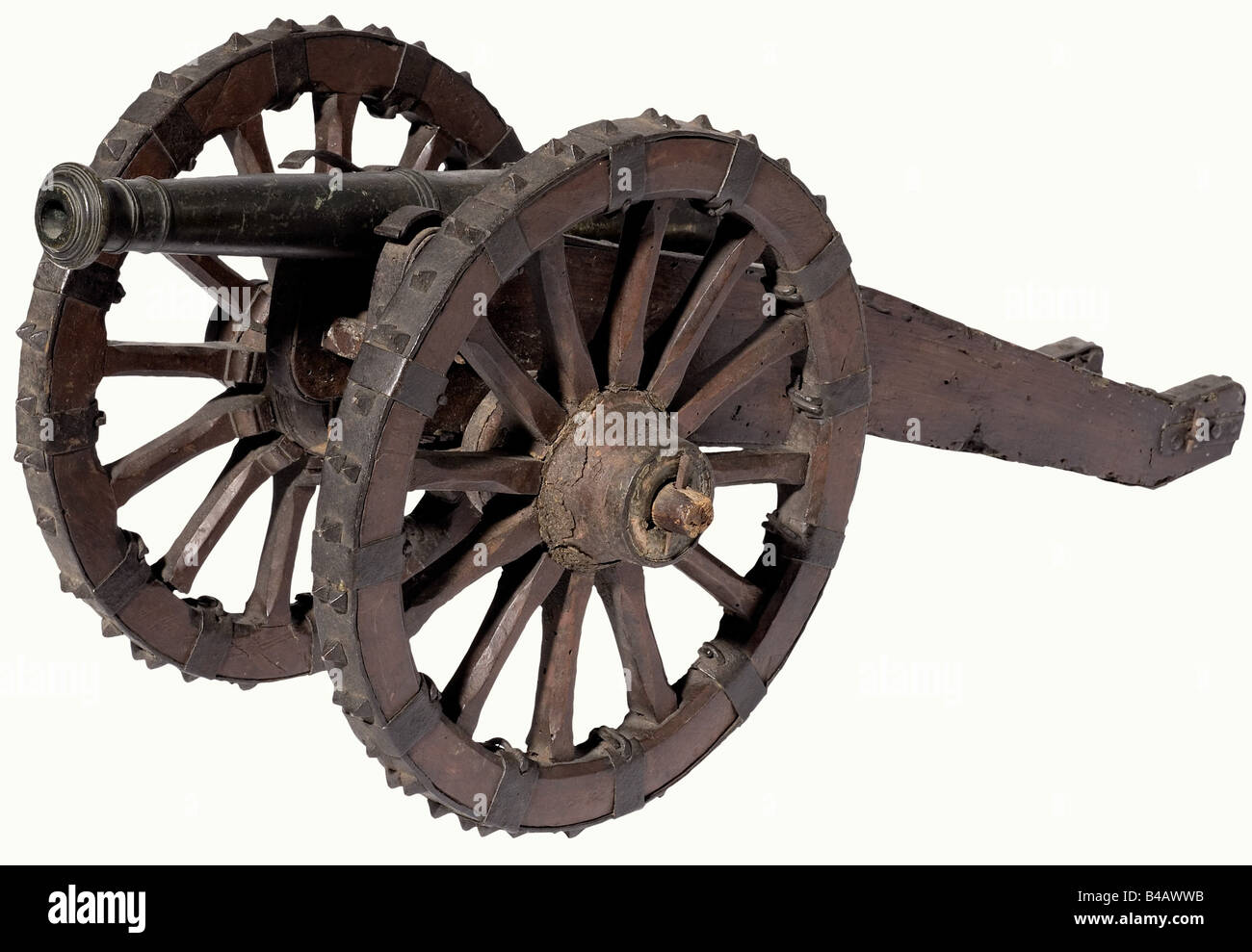 A model field gun, 17th century. Slender bronze barrel in 15 mm caliber with a cannon muzzle, side trunnions, vent - Stock Image