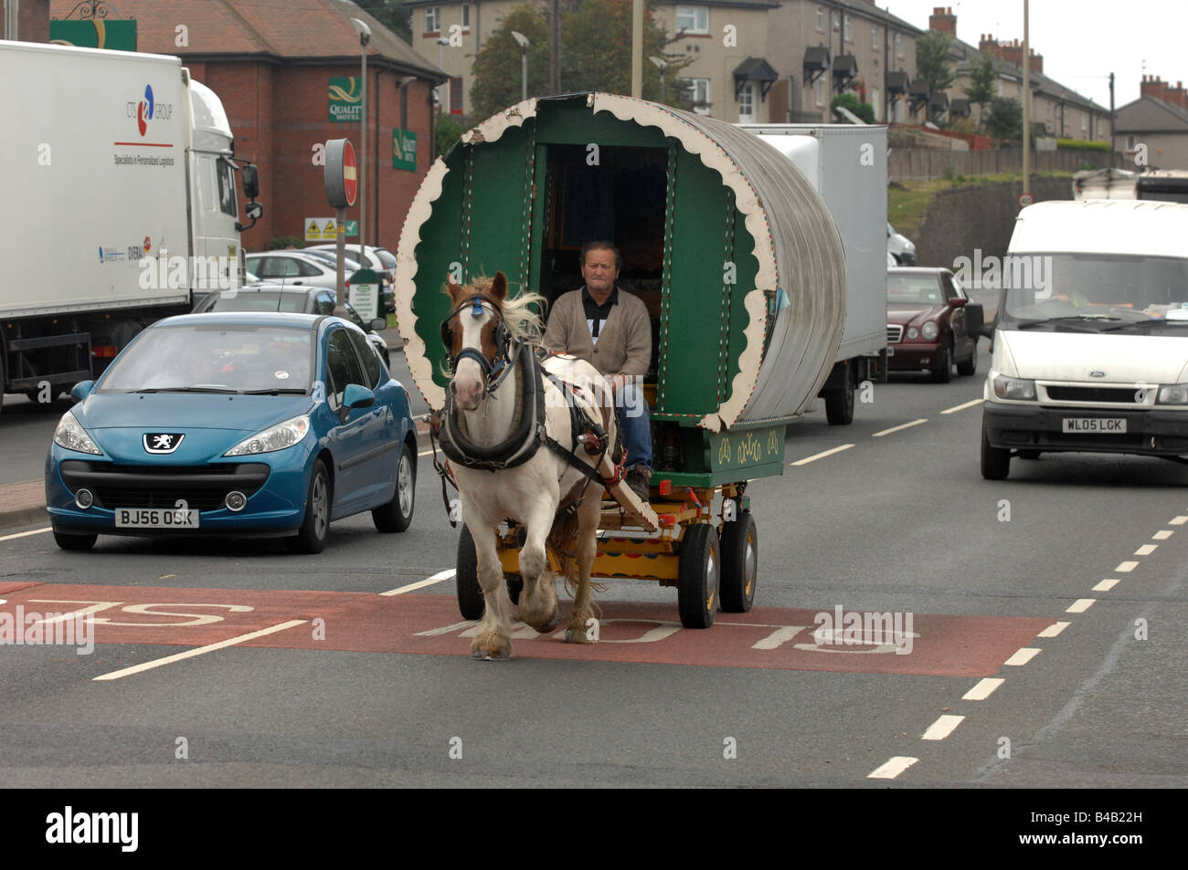 Horse drawn caravan travelling through Dudley in the West Midlands England - Stock Image