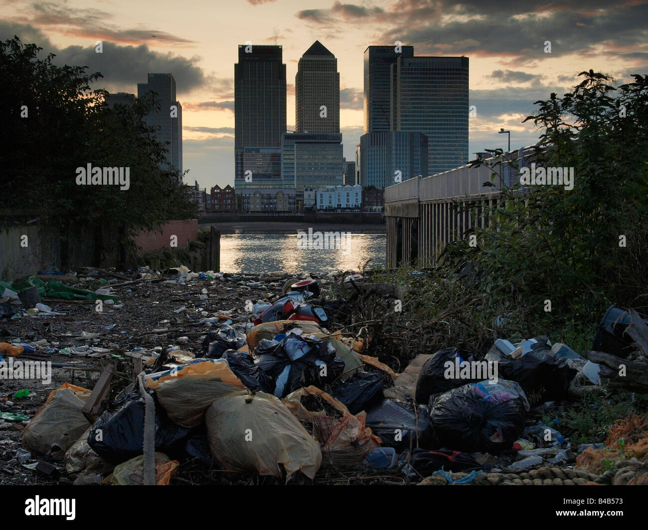 Lots of garbage with the Docklands skyline in the background Canary Wharf London UK - Stock Image