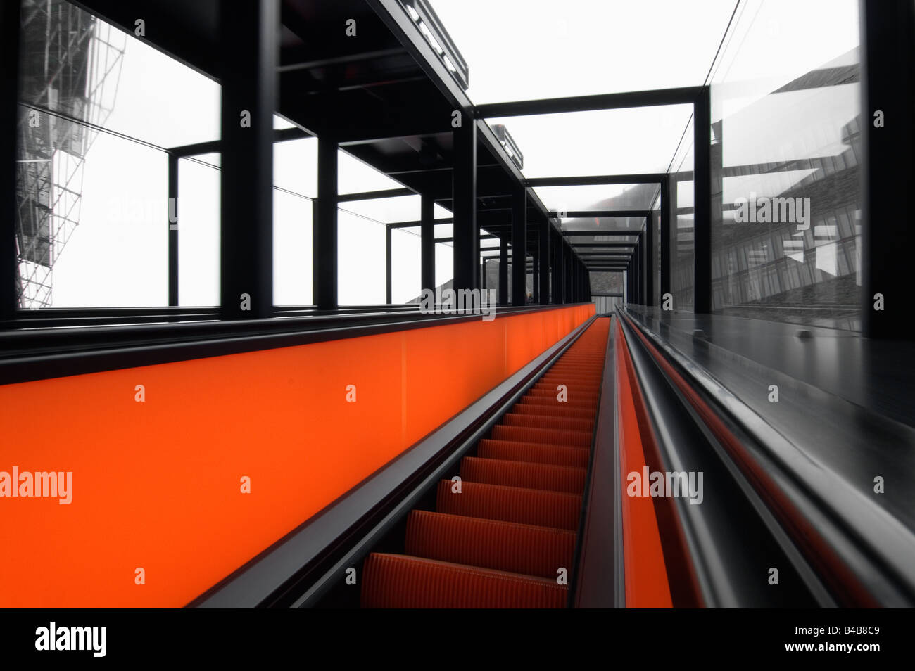 Red lighted escalalator at Weltkulturerbe Zeche Zollverein in Essen Germany - Stock Image