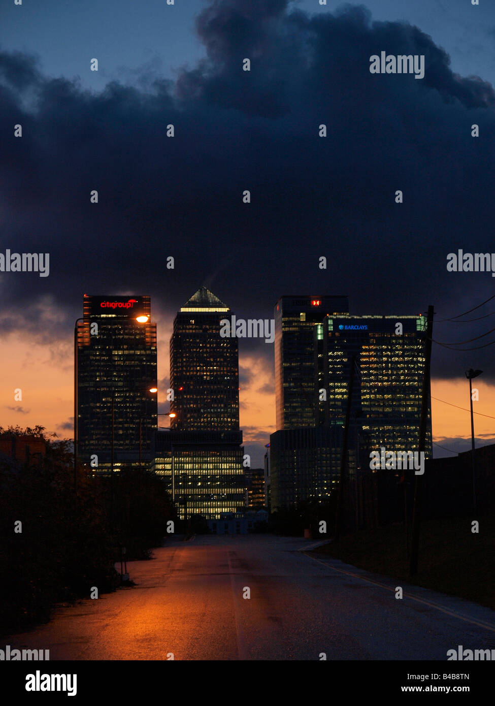 Canary Wharf bank towers at night vertical Docklands London UK - Stock Image