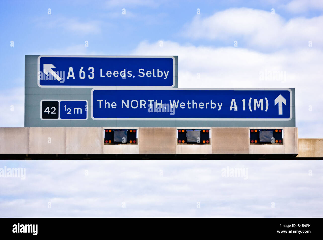 UK motorway overhead gantry destination and exit route signs England UK - Stock Image
