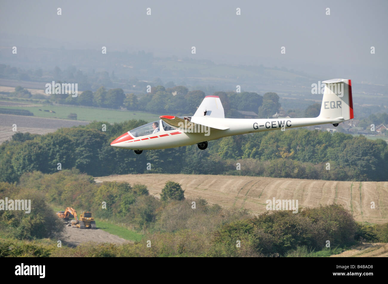 Glider flying over crop fields Dunstable Downs England Stock Photo