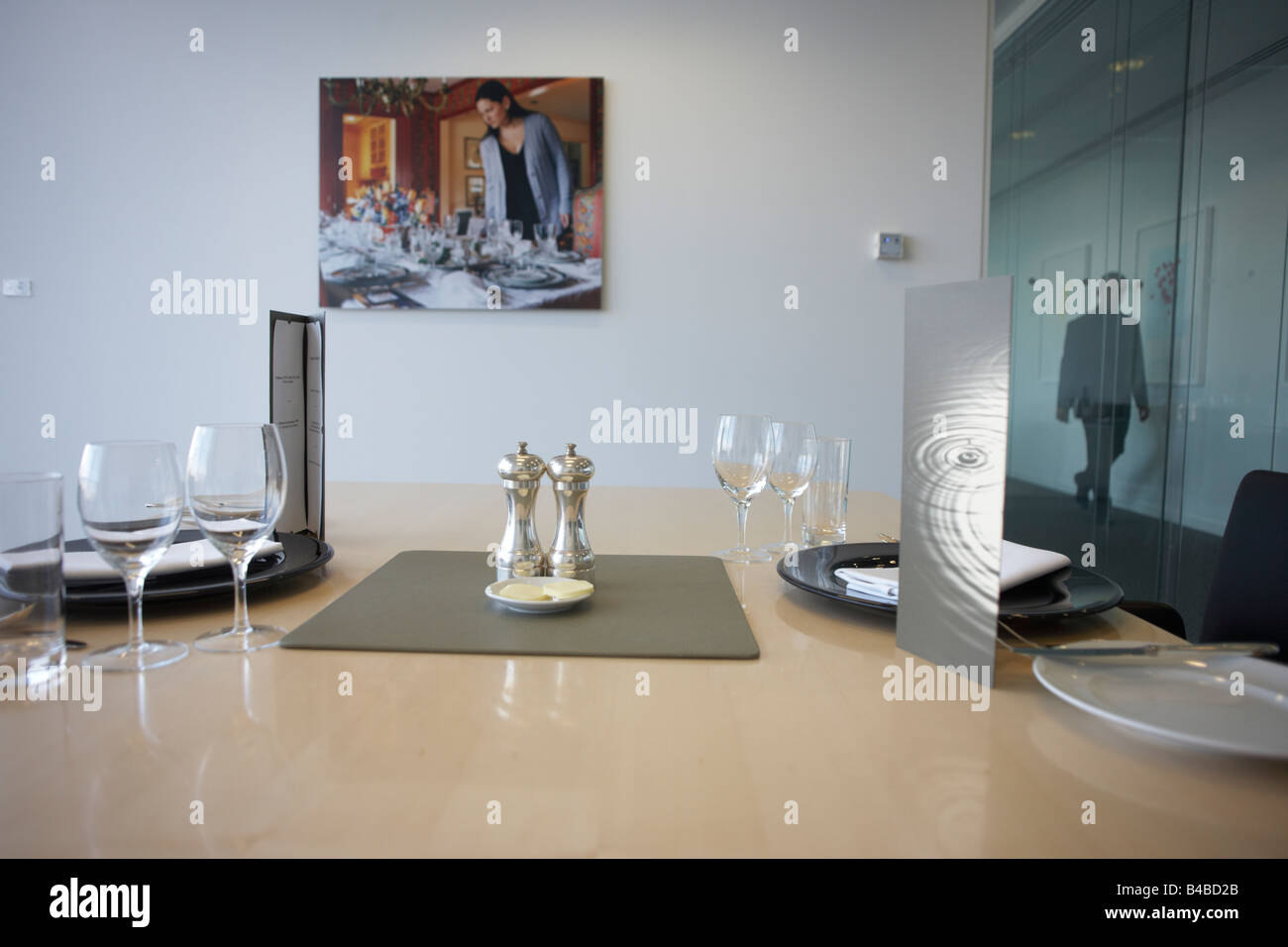 Top floor restaurant prepared for executive lunch meetings in an auditing company's London headquarters - Stock Image