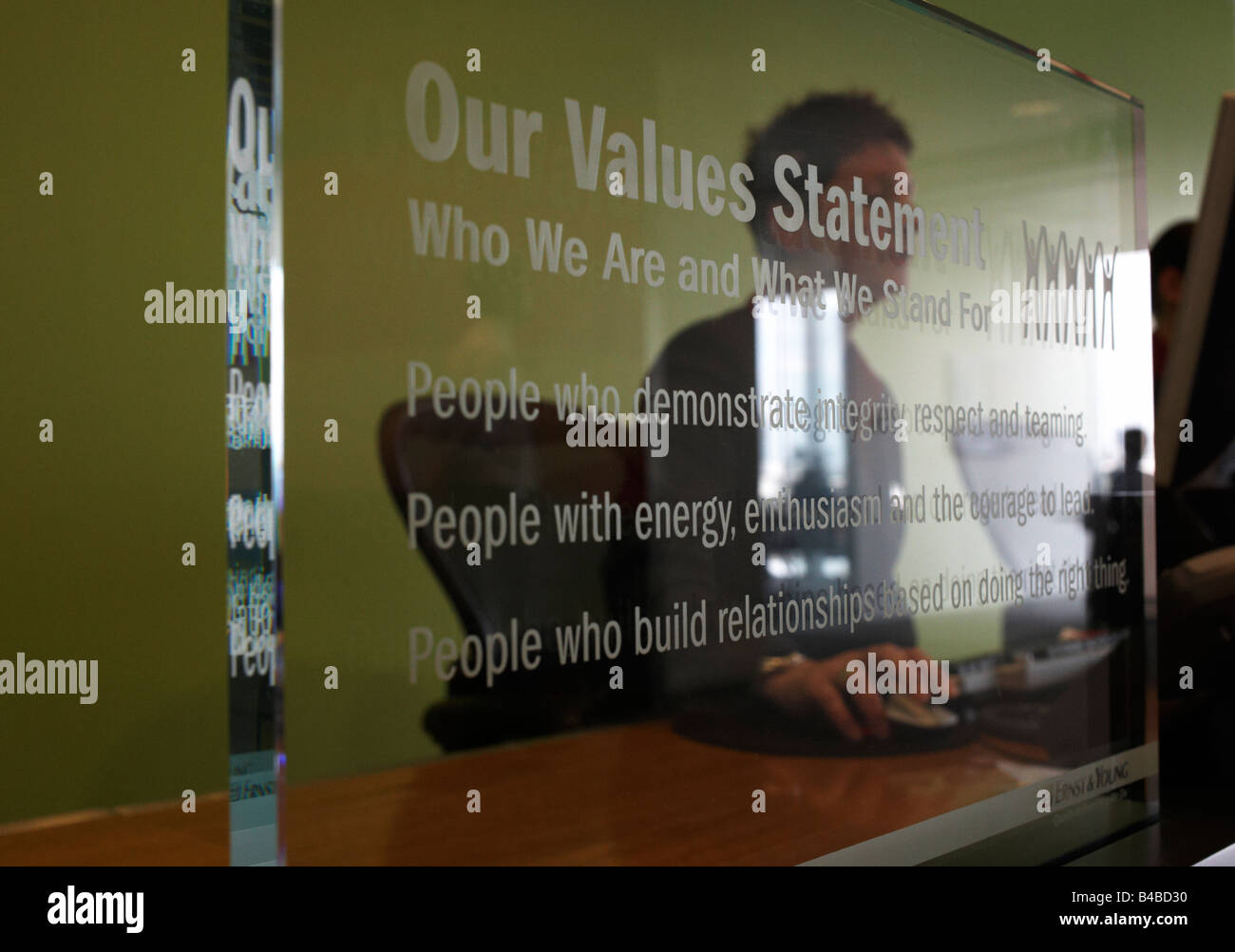 Corporate values statement written onto transparent screens at an auditing company's European headquarters - Stock Image